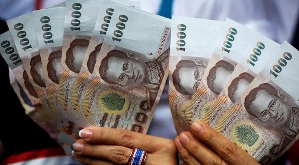 Thai central bank steps in to curb baht price's surge